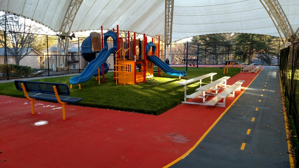 school lawn install for playground, artificial turf