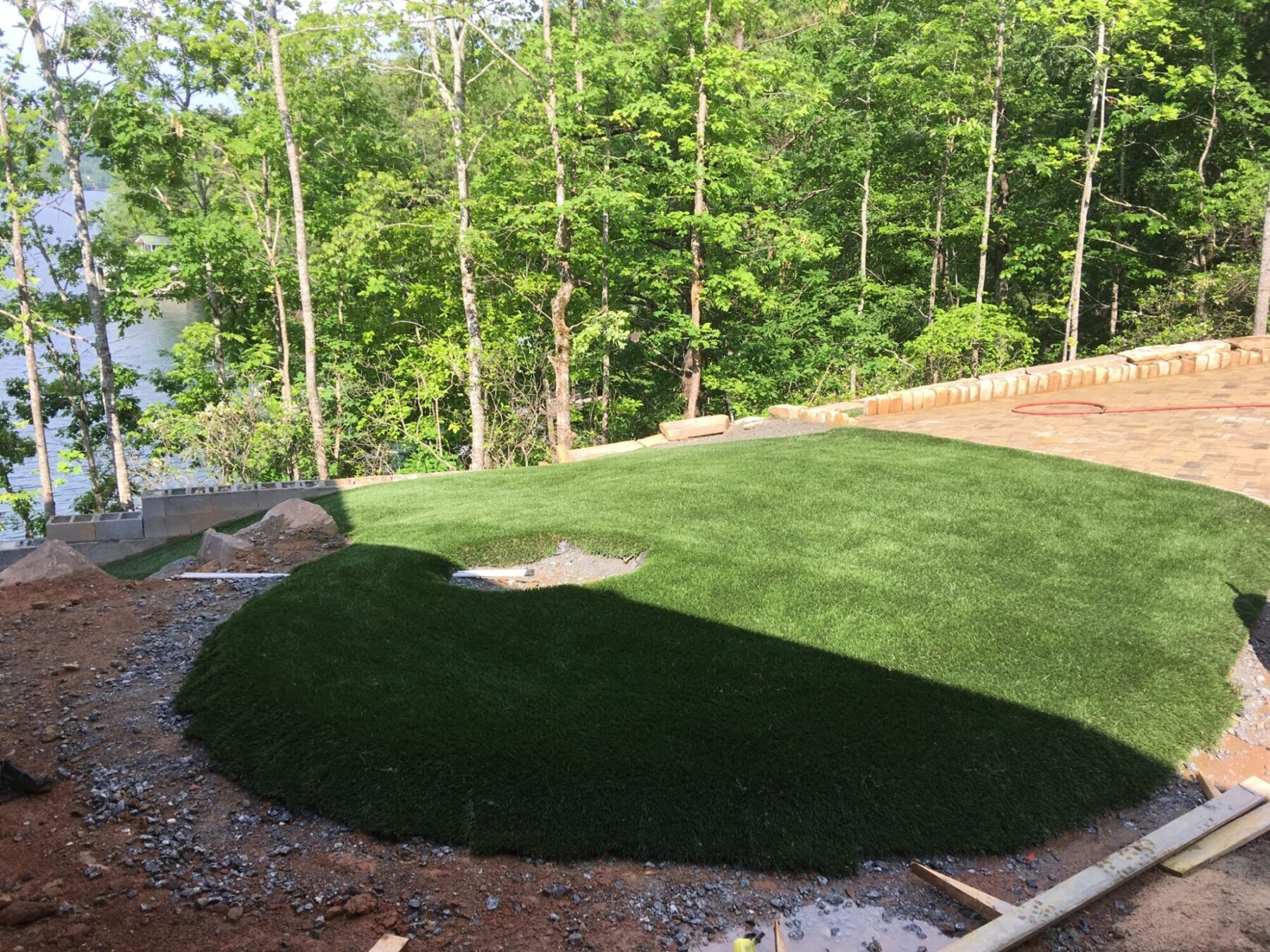 residential home with artificial grass installation