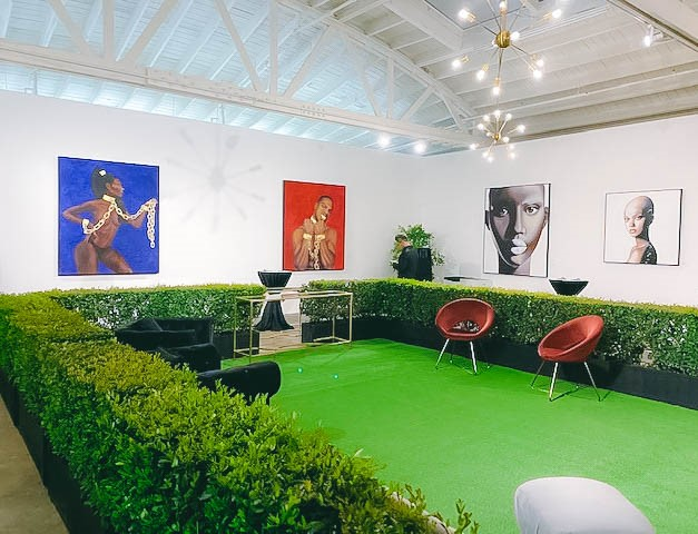 Bria Murphy, daughter of actor and comedian Eddie Murphy implements SYNLawn artificial grass during art exhibit in L.A.