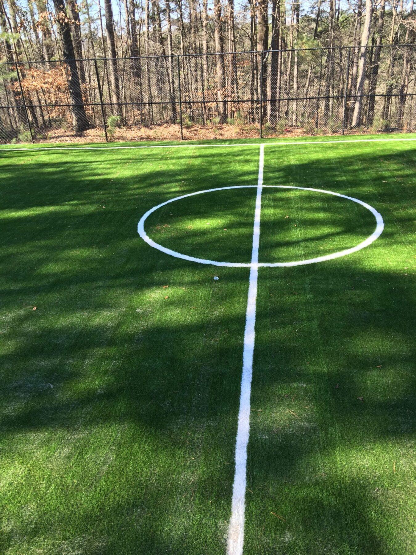 artificial grass installation for sports field