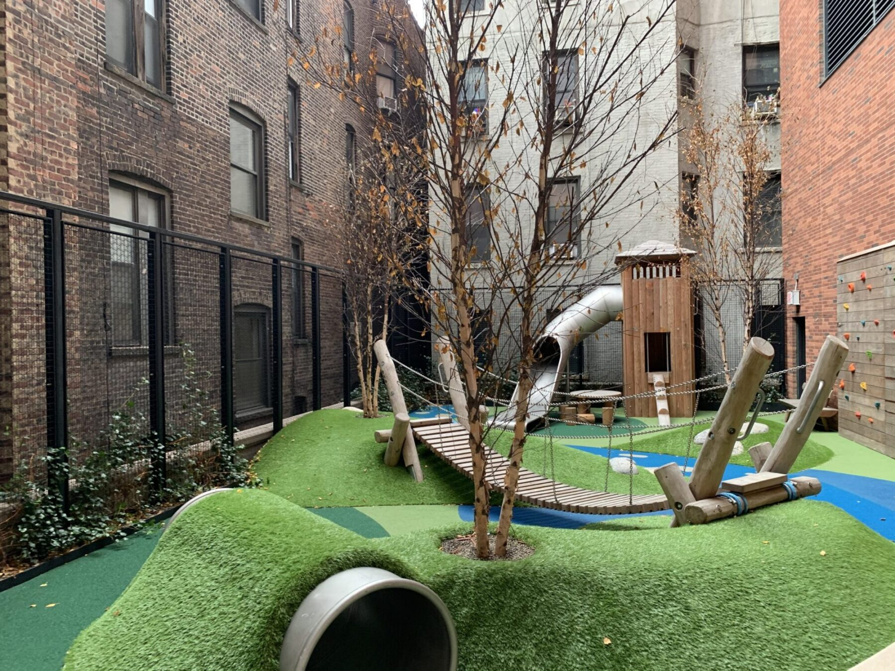 The Kent Rooftop Playground was one of the more challenging projects we completed this year as you will see in the photos. The Kent is a tailored collection of 3 to 5 bedroom condominium residences complimented by 3 levels of curated outdoor & indoor spaces and amenities. Art-deco design by award winning architects Beyer, Blinder & Belle and interior designer Alexandria Champalimaud. We installed the SYNLawn on the 2nd floor 'Camp Kent' where celebrities like Hoda Kotb live and take their children for outdoor recreation time for a fun and environmentally safe adventure